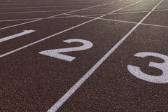 Sprinting Track Starting Line Curve. Sprinting track showing the numbers near a starting line stock images