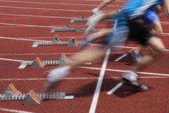 Sprintstart. Sprinters out of the starting block Royalty Free Stock Images