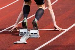 Sprintstart in der Leichtathletik Stockbild