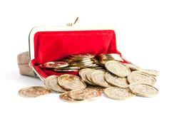 Spritt försilvra, och guld- myntar royaltyfri foto
