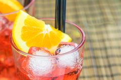 Spritz aperitif aperol cocktail with orange slices and ice cubes Stock Photos