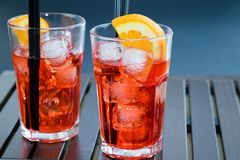 Spritz aperitif aperol cocktail with two orange slices and ice cubes Royalty Free Stock Photo