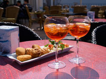 Spritz aperitif in Italy. Spritz aperitif served with Grissini in a restaurant in Italy royalty free stock photo