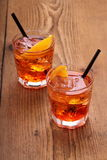 Spritz aperitif, two orange cocktail with ice cubes Stock Image