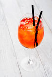 Spritz Aperol cocktail in wine glass on rustic wooden background Stock Photos