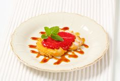 Spritz cookie with raspberry sauce Stock Photography