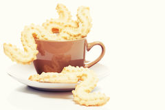 Spritz cookies for christmas in a coffee cup Royalty Free Stock Photo