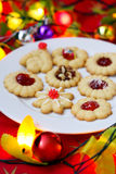 Spritz cookies filled with jam and decoration for Royalty Free Stock Photos