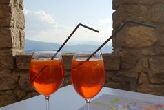 Spritz with wonderful landscape. A relaxing italian spritz in an ancient castle with a wonderful landscape stock images