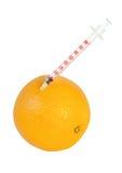 Spritze in der Orange getrennt auf Weiß Stockfoto