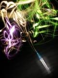 Spritze, die farbige Leuchte sprüht Stockfotografie