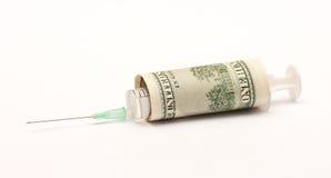 Spritze eingewickelt in einem Dollarschein Stockfotografie