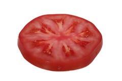 Spritze gestoßen in Tomate Stockfotos