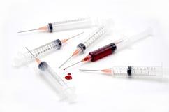 Spritze mit Blut Stockfotografie