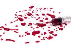 Spritze und Blut Stockbild