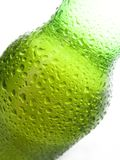 Spritzed Beer Bottle. Green glass beer bottle, back-lit and spritzed with water Royalty Free Stock Photography