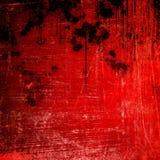 Spritzen auf rotem Lackhintergrund Stockfotos