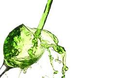 Spritzen der Flüssigkeit Stockbild