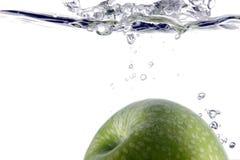 Spritzen des Apfels Stockbild