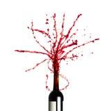 Spritzen des Rotweins Stockfoto