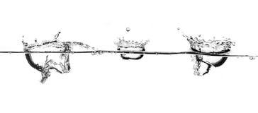 Spritzen des weißen Wassers Stockfoto