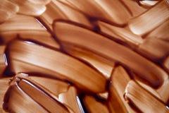 Spritzenwellen-Schokoladenhintergrund, Muster Stockfoto