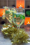Spritzer cocktail with white wine, mint and ice, decorated with spiral lemon zest Royalty Free Stock Photos