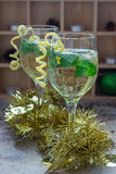 Spritzer cocktail with white wine, mint and ice, decorated with spiral lemon zest Stock Photo