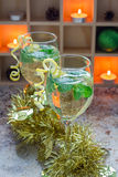Spritzer cocktail with white wine, mint and ice, decorated with spiral lemon zest. Vertical Stock Photos