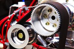 The sprocket. A powerful dragster car engine. Sprocket with belt stock images