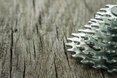 Sprocket cassette for bycicle. On wooden board stock images