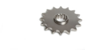 Sprocket Gear. Motorcycle gear sprocket macro isolated on white stock photo