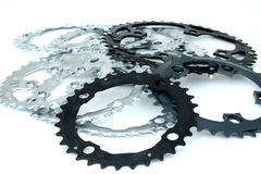 Sprockets. A mess of sprockets on white royalty free stock image
