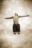 Sprong aan de hemel Stock Foto's