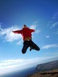 Sprong aan paradijs Stock Foto