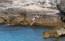 Sprong in het water Stock Afbeelding