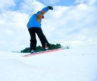 Sprong met snowboard stock afbeelding