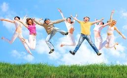 Sprong van een groep mensen stock foto