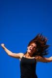 Sprong voor vreugdemeisje Stock Foto's