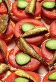 Sprotten schieben mit Tomate und Gurke ein Stockfotos