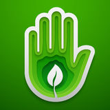 Sprout in hand shape. Paper art for the Earth Day decoration. Vector illustration of ecology idea. Concept design. Royalty Free Stock Images