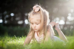 Sprout plant growing from little girl hands Royalty Free Stock Image