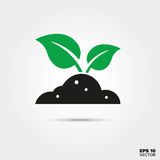 Sprout in soil Icon. Environment and Nature Symbol. Green sprout in Black Soil Icon. Environment, Nature and Reforestation Symbol. EPS 10 Vector Royalty Free Stock Images