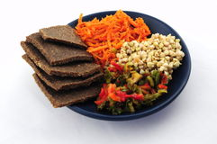 Sprouted buckwheat, flax breads, pepper and carrot Stock Photos