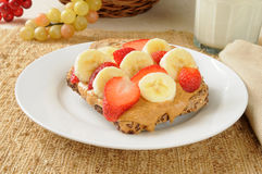 Peanut butter sandwich with banana and strawberries Stock Image