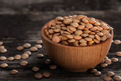 Sprouting Seeds in a Wooden bowl. Close-up of Brown Lentils Sprouting Seeds in a Wooden bowl Stock Photography