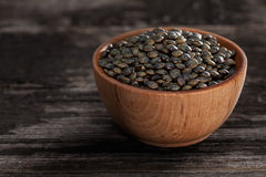 Sprouting Seeds in a Wooden bowl. Close-up of French Lentils Sprouting Seeds in a Wooden bowl Royalty Free Stock Image