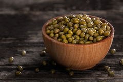Sprouting Seeds in a Wooden bowl. Close-up of Green Peas Sprouting Seeds in a Wooden bowl Royalty Free Stock Photography