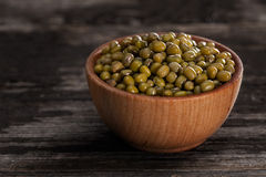 Sprouting Seeds in a Wooden bowl. Close-up of Green Peas Sprouting Seeds in a Wooden bowl Royalty Free Stock Image