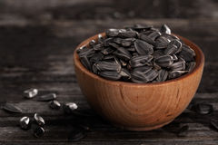 Sprouting Seeds in a Wooden bowl. Close-up of Sunflower Sprouting Seeds in a Wooden bowl Royalty Free Stock Photography